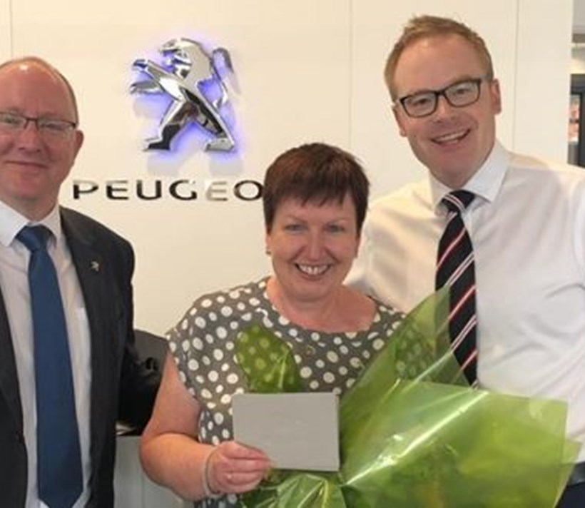 SALES ADMINISTRATOR SUE DIXON WHO LAST WEEK REACHED 25 YEARS SERVICE WITH PEUGEOT!