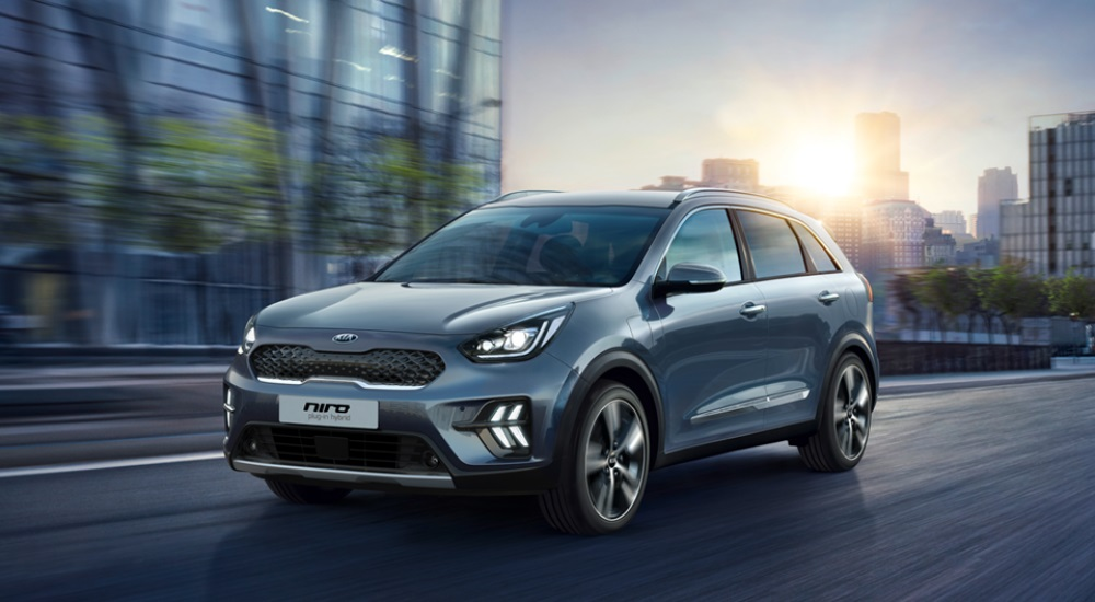 Silver Kia Niro Plug-in Hybrid driving on road