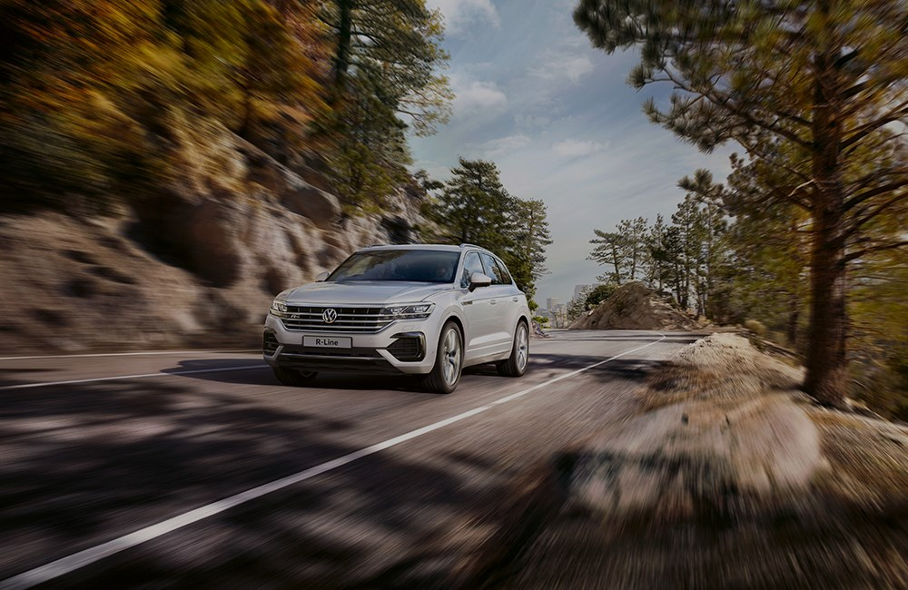 Silver Volkswagen Touareg on country road