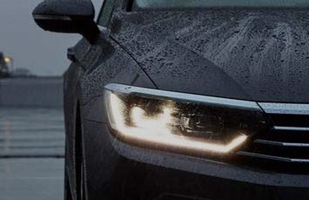 Black Volkswagen with illuminated front light