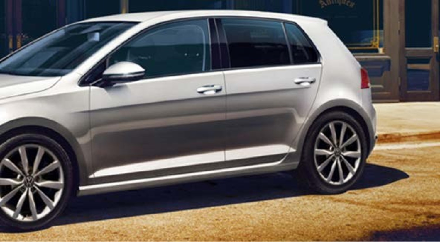 Silver Volkswagen Polo from the side