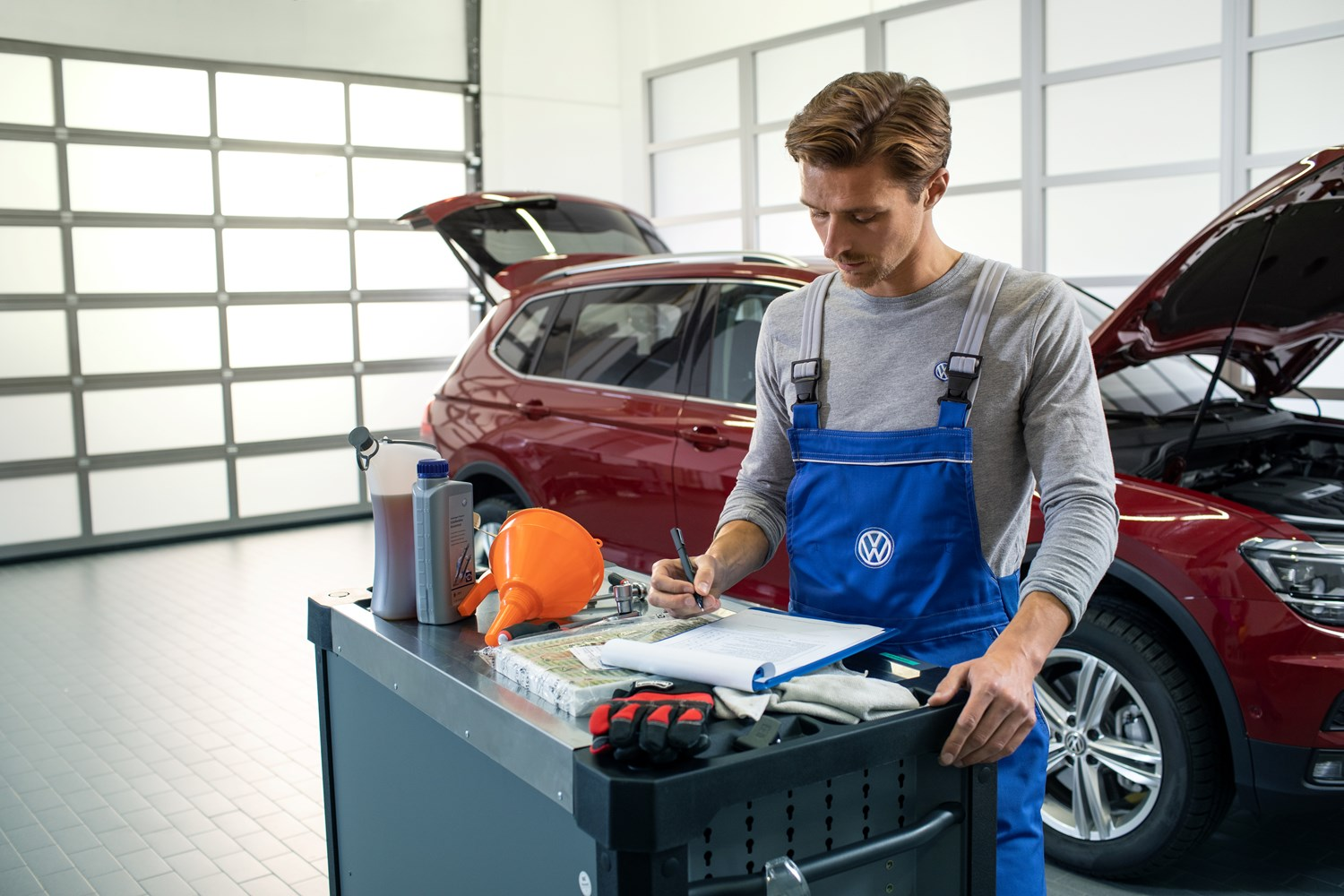 Mechanic filling out paper work