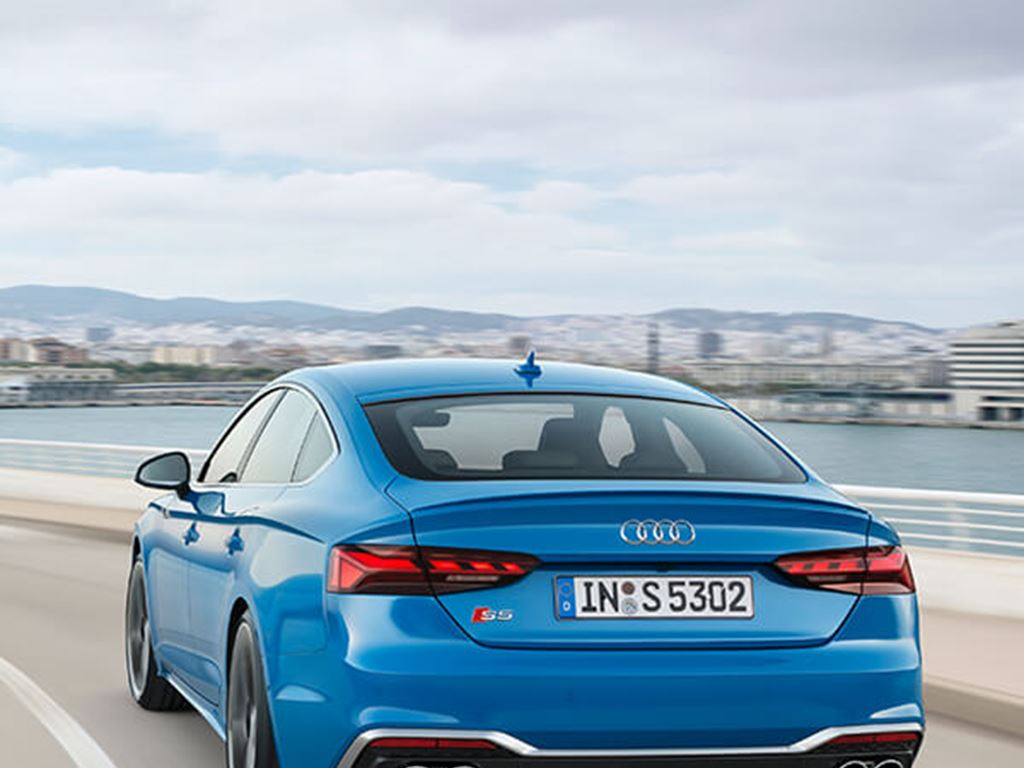 S5 Sportback in blue driving rear view