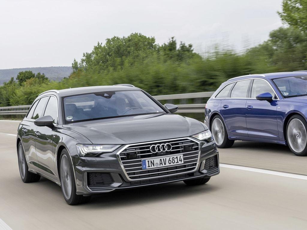 two A6 Avants driving side by side
