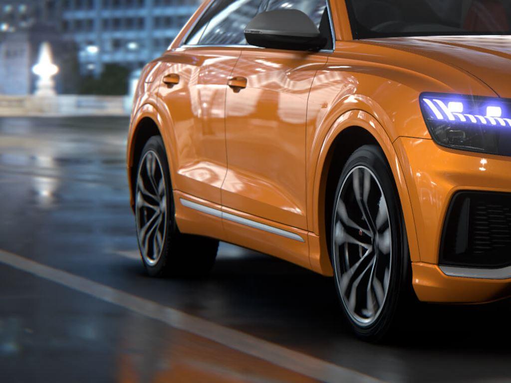 Orange SQ8 on the road