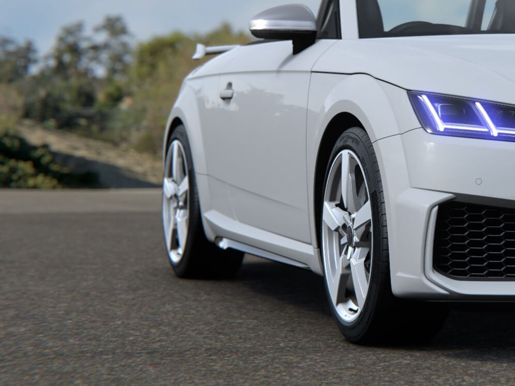 White TT RS Roadster parked on road