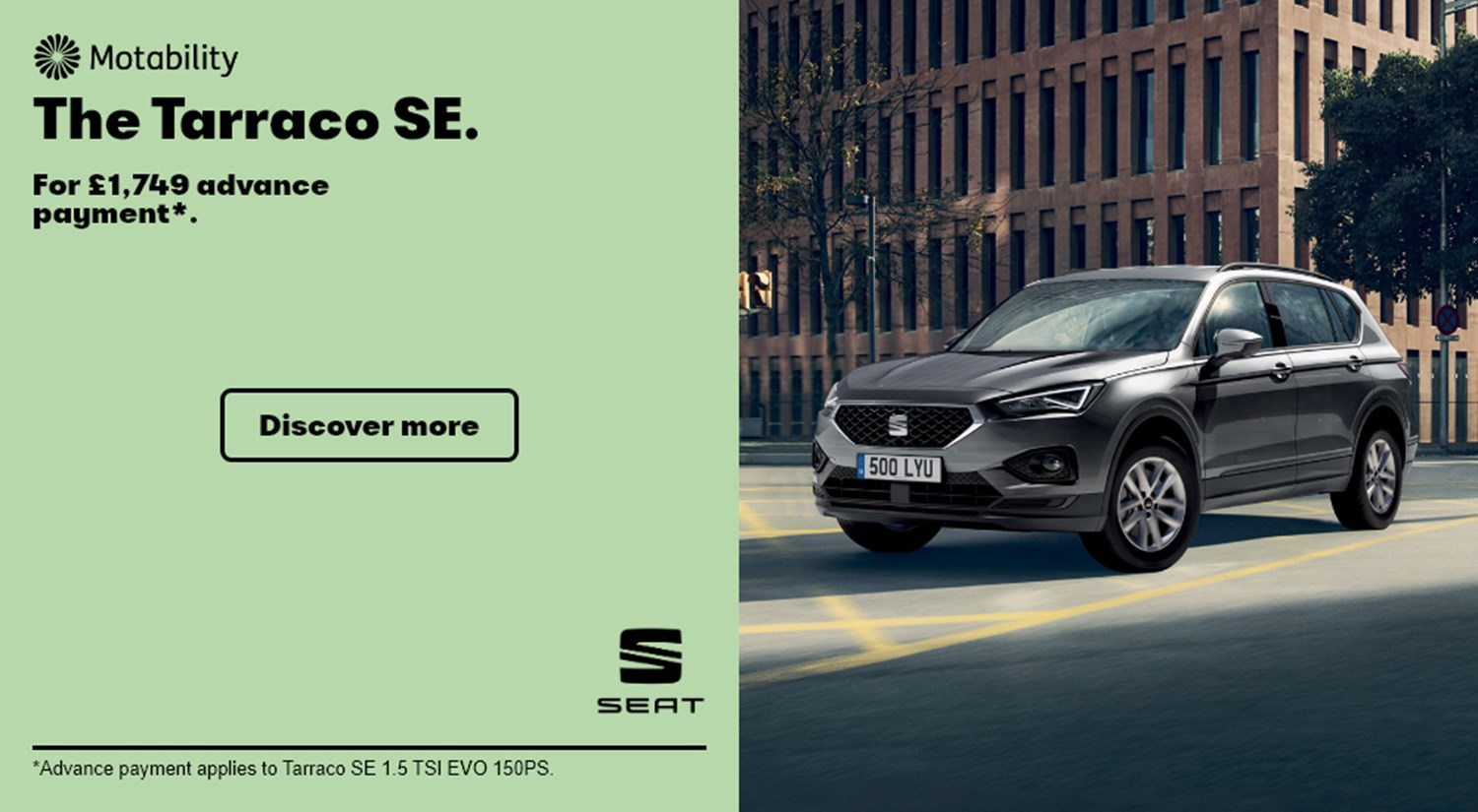 Grey SEAT Tarraco SE parked on road Motability banner