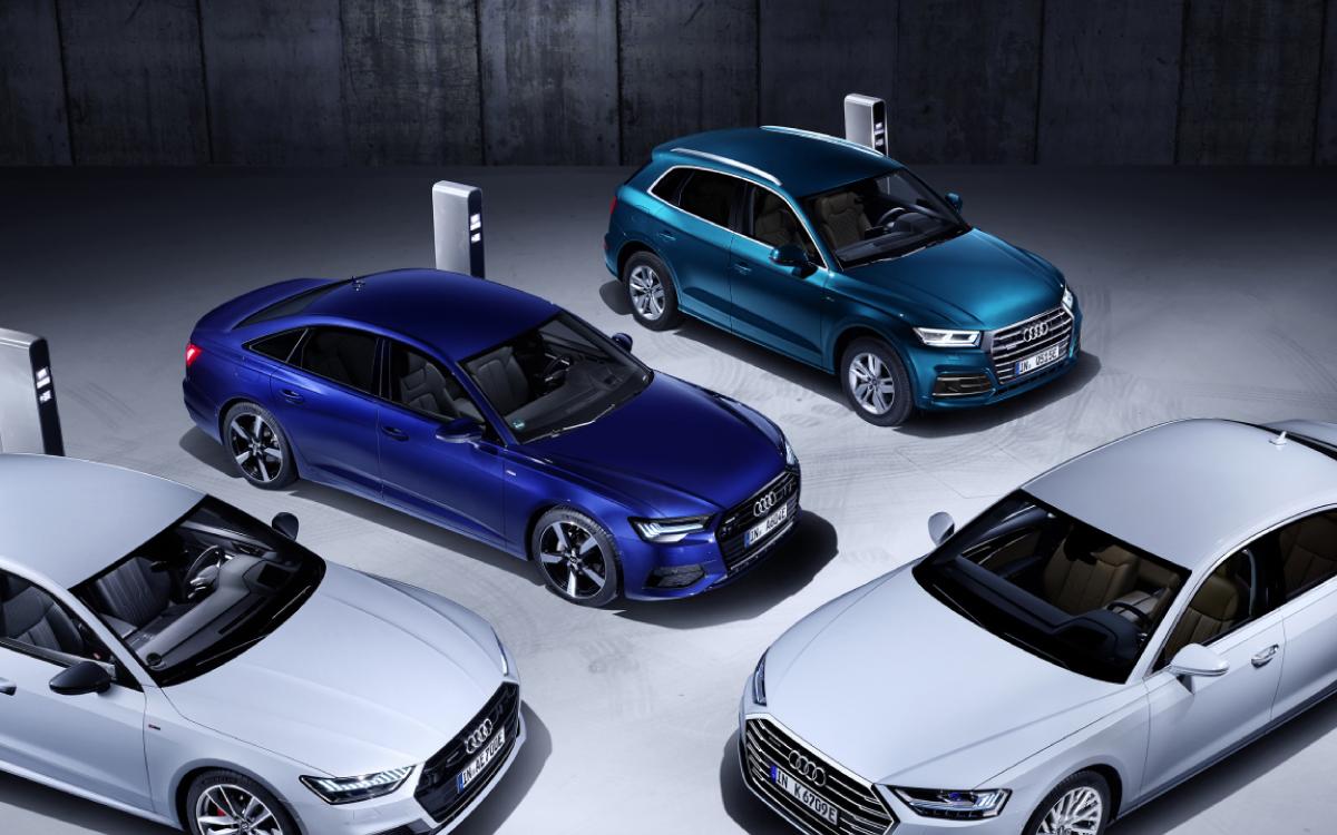 4 Audi vehicles parked