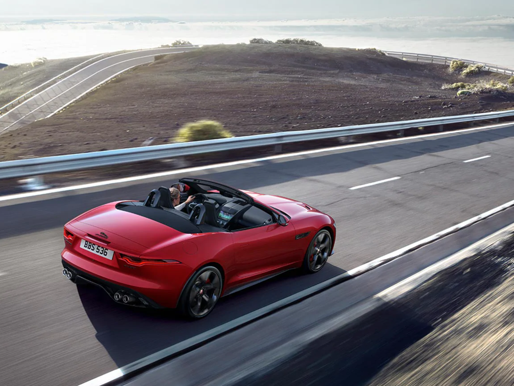 Red Jaguar Convertible on the road