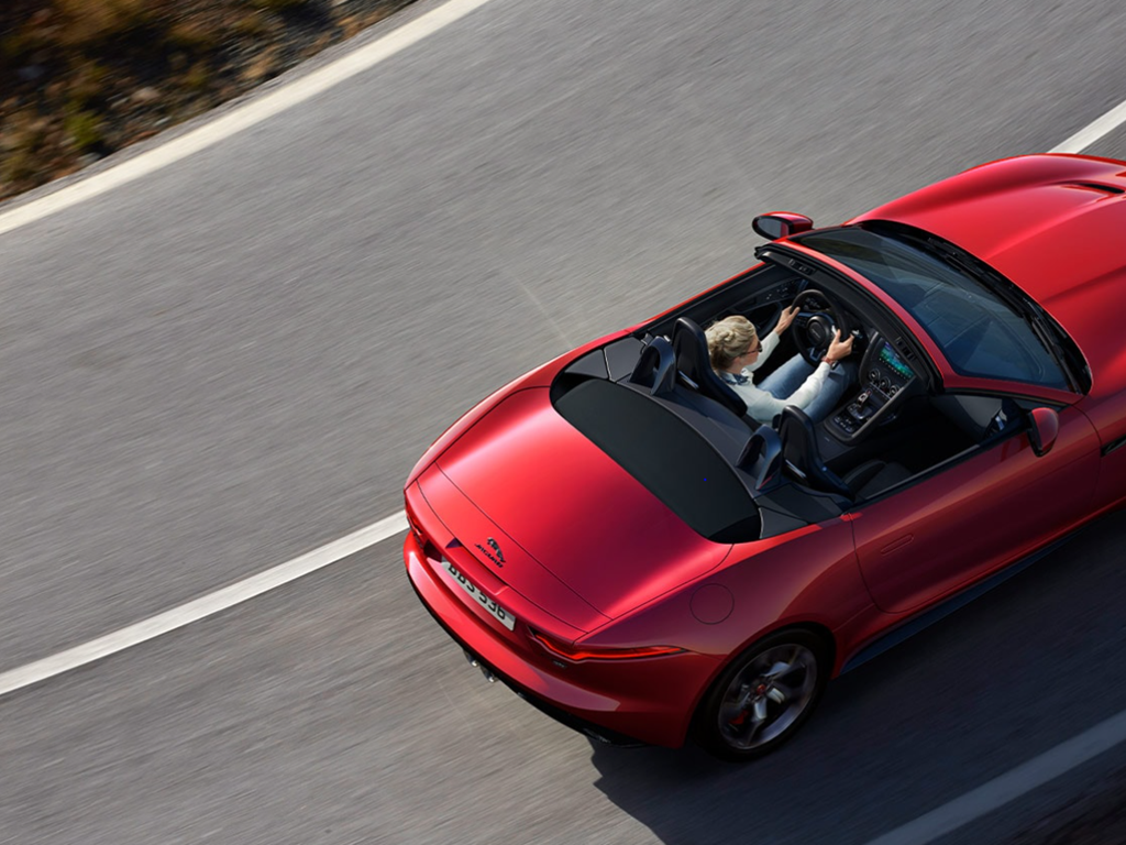Red Jaguar Convertible on the road view from above