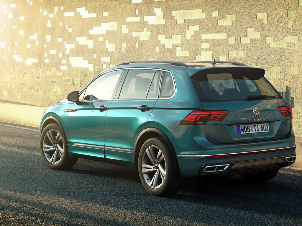 New VW Tiguan on the road rear and side view