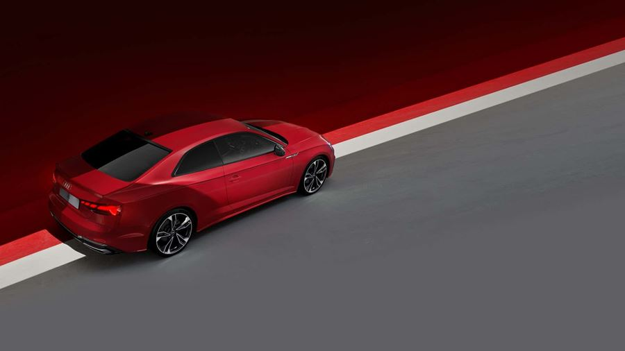 red Audi A5  with grey and red background