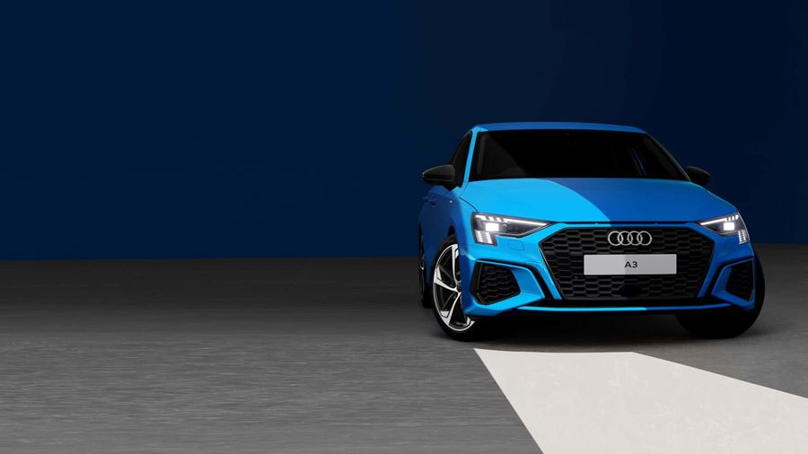Audi A3 in blue with blue wall and grey floor background