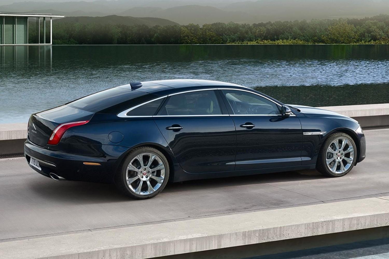 Black Jaguar XJ in front of water