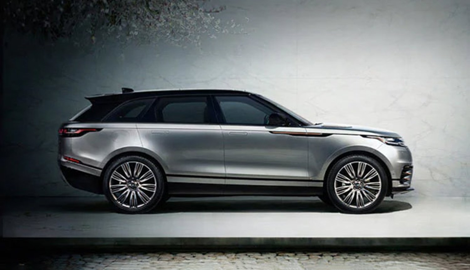 Range Rover Velar in Silver in front of wall